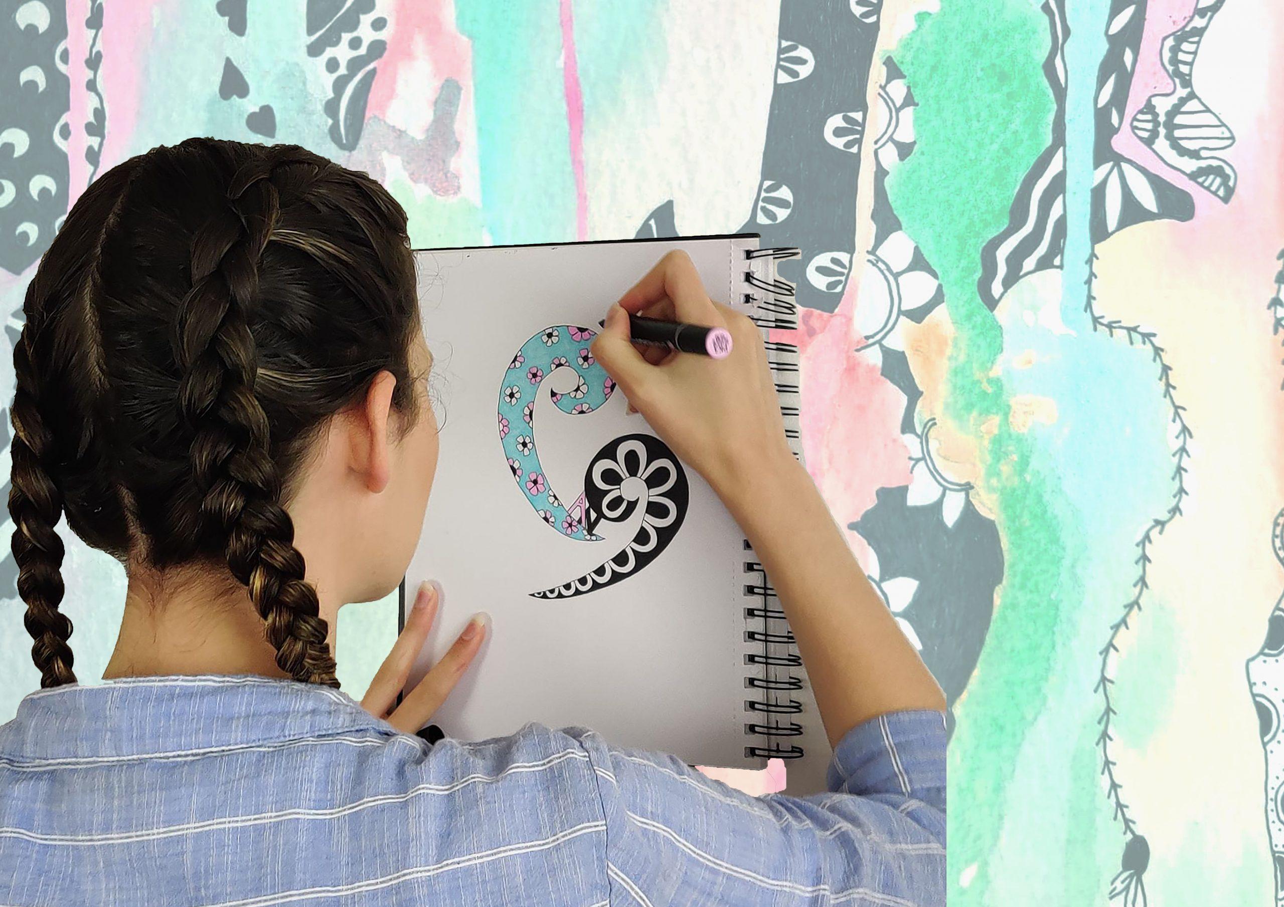 artist drawing logo